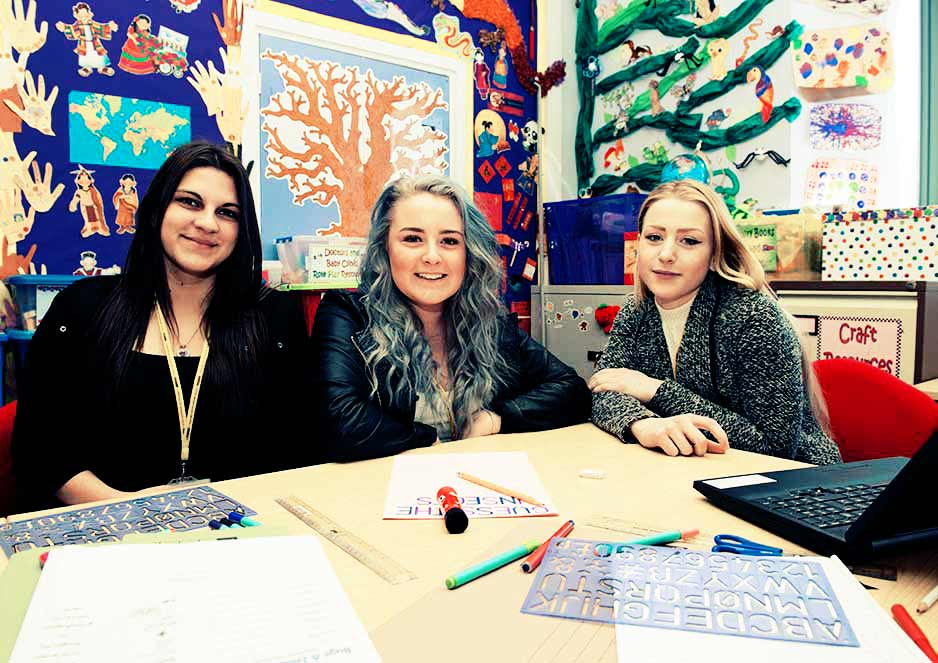 Childcare students work together to create colourful and creative activities for little ones.